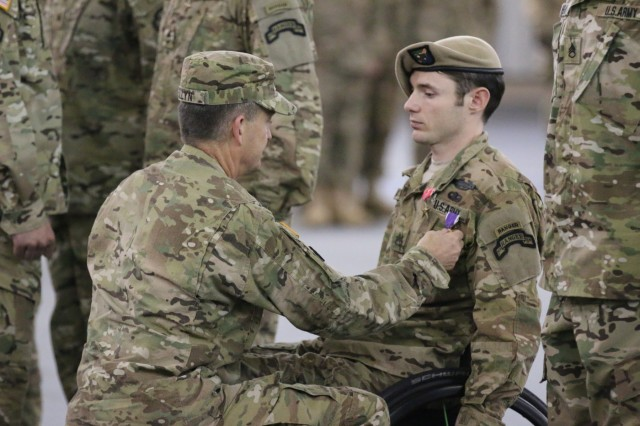 Gen. Daniel B. Allyn, Army vice chief of staff, presents Staff Sgt. Travis D. Dunn, Bravo Company, 1st Battalion, 75th Ranger Regiment, with the Bronze Star with Valor and a Purple Heart during the Battalion Award Ceremony on Hunter Army Airfield in Savannah, Ga., April 29, 2015.