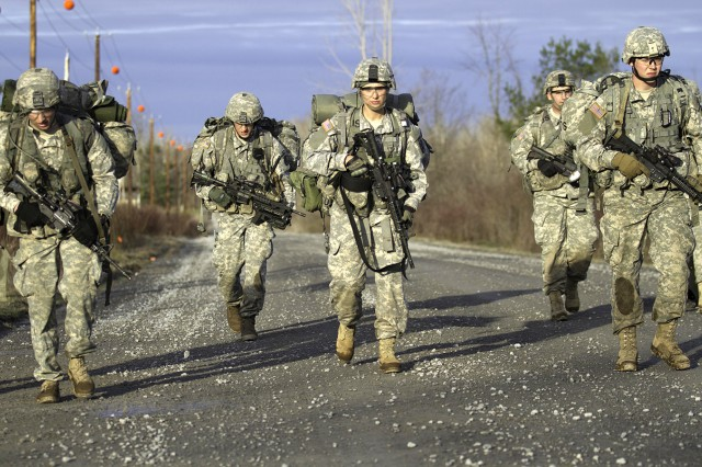 A team of lieutenants ruck marches to their next grid coordinate April 23 during 4th Battalion, 31st Infantry Regiment, 2nd Brigade Combat Team's Platoon Leader Challenge.
