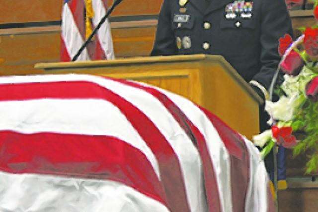 Capt. Ryan Ball speaks during the repatriation memorial service.