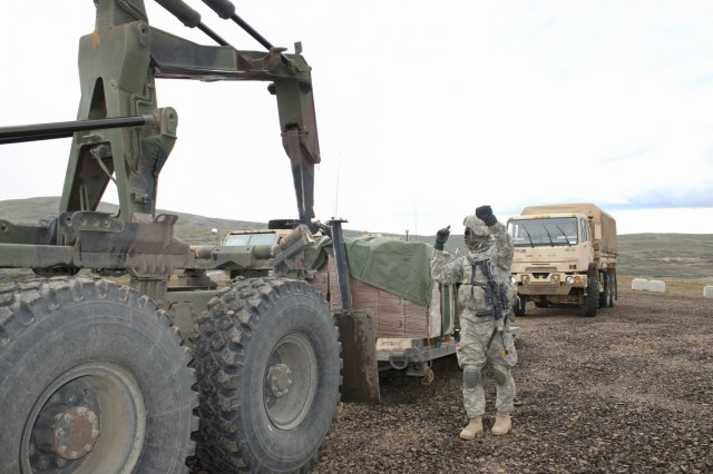 U.S. Army Pfc. David Kablan, a truck driver with 296th Brigade Support Battalion, helps load supplies during a logistics resupply point at Yakima Training Center, Wash., April 9, 2015. Logistics resupply points help keep the brigade up and running by delivering much-needed supplies. (U.S. Army photo by Staff Sgt. Justin Naylor, 3-2 Stryker Brigade Combat Team Public Affairs)