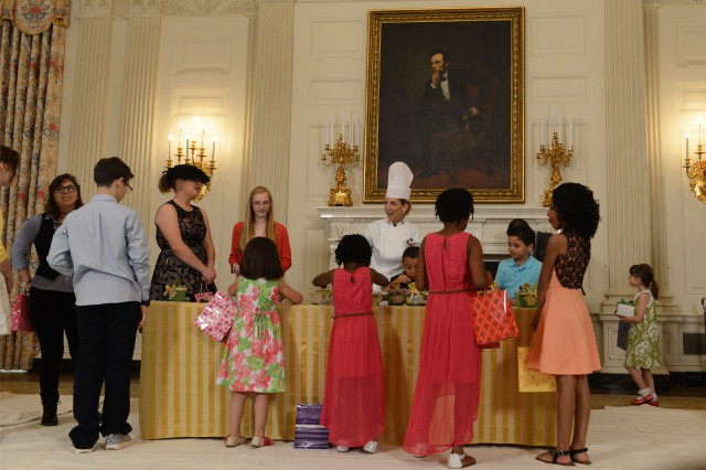 Children create gifts for their mothers during a Mother's Day tea hosted by First Lady Michelle Obama and Dr. Jill Biden to honor military mothers at the White House, May 8, 2015.