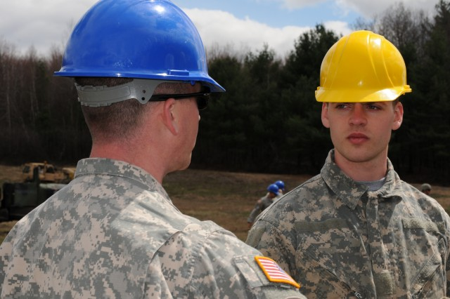 Pfc. Justin Barker (R), a Wheeled Vehicle Mechanic assigned to 319th Quartermaster Battalion, Twinsburg, Ohio, receives guidance from Sgt. 1st Class Kevin Hiles, a Wheeled Vehicle Recovery Course instructor during a simulated recovery mission at Regional Site Training-Maintenance Devens, April 23, 2015.