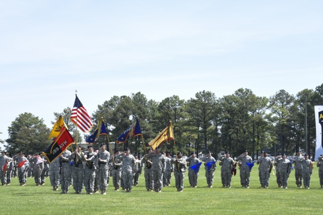 Soldiers from the 159th Combat Aviation Brigade, 101st Airborne Division (Air Assault), pay honors to the nation during the national anthem at the Thunder Brigade's inactivation ceremony at the division parade field on Fort Campbell, Ky., May 7, 2015. The 159th CAB cased its brigade colors for the final time during the ceremony, as well as all of its subordinate battalion colors and company guidons. The brigade's lineage dates back to the Vietnam War, but its most active role was in the Global War on Terrorism where it supported operations in Afghanistan and Iraq six times since 2002.