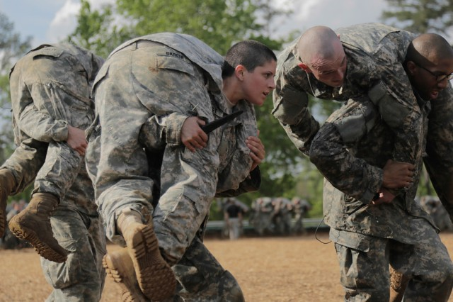 Soldiers participate in combatives training during the first gender-integrated Ranger Course on Fort Benning, Ga., April 20, 2015.