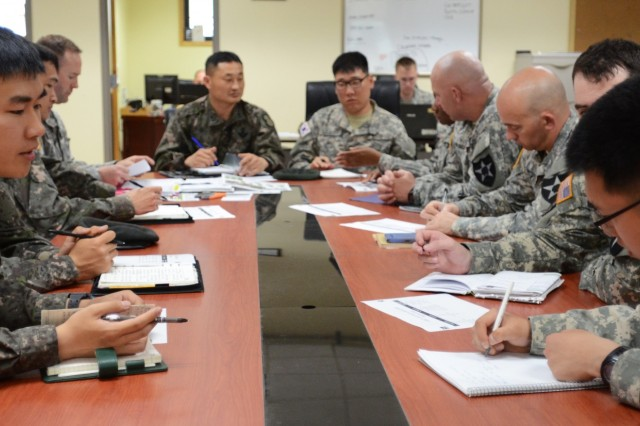 Republic of Korea army leaders from the 16th Mechanized Infantry Brigade, 8th Infantry Division, discuss with 1st Armored Brigade Combat Team, 2nd Infantry Division, staff tactics and techniques regarding weapons of mass destruction removal operations May 3 at Camp Hovey, South Korea. The staff also clarified future plans for WMD operations after 1st ABCT is deactivated and is replaced by 2nd Brigade Combat Team, 1st Cavalry Division in July.