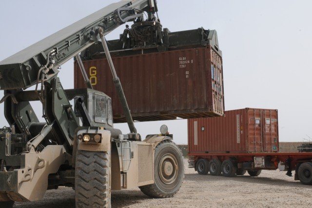Soldiers use a RT-240 Kalmar to unload a container from a trailer. (Courtesy photo by Sgt. Ryan Twist)
