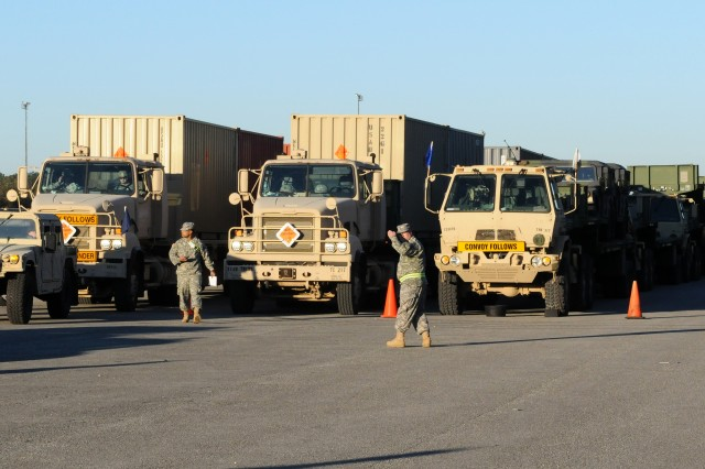 Soldiers assigned to a Georgia National Guard transportation company prepare to convoy from Military Ocean Terminal -- Sunny Point on the North Carolina coast to Goose Creek, South Carolina, March 17. Operation Patriot Bandoleer teamed up the Army Sustainment Command with NG units to move Army Prepositioned Stocks from MOTSU to depots across the nation for long-term storage. (Photo by Sgt. 1st Class Shannon Wright, ASC Public Affairs)