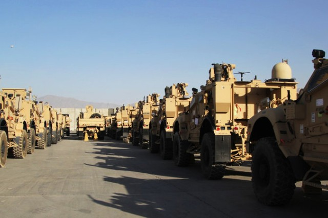 Armored vehicles lined upon the tarmac at Bagram, Afghanistan. Enduring Freedom. (Courtesy photo by Sean Carberry)