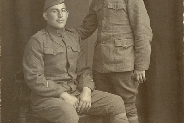 Portrait of Sgt. William Shemin (seated) with another Soldier posed.