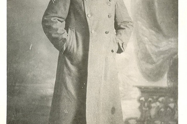 Portrait of Sgt. William Shemin in uniform overcoat.