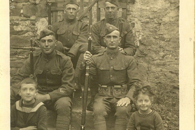 Photo of Sgt. William Shemin (front row, left) sitting on steps.