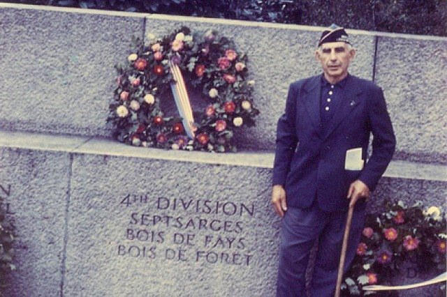 Photo of William Shemin standing at the 4th Infantry Division monument in France: Septsarges, Bois de Fays, Bois de Foret.