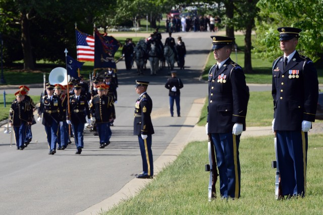 "Soldiers, with the 3d U.S. Infantry Regiment (The Old Guard), are seen in the foreground as the U.S. Army Band ""Pershing's Own"" participates in the funeral of Master Sgt. James W. Holt, who went missing and was presumed killed in action during the Vietnam War. Holt was buried with full military honors at Arlington National Cemetery, Va., May 14, 2015."