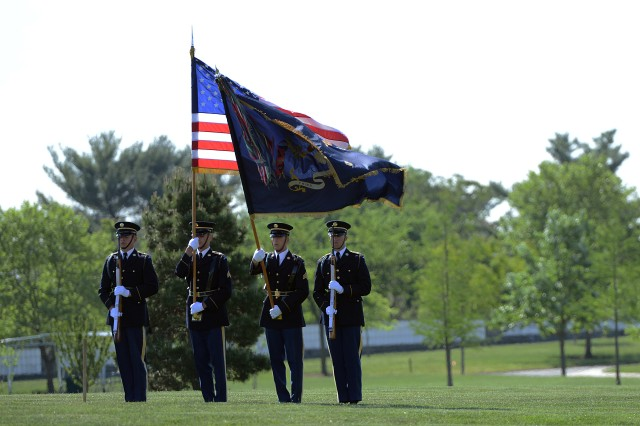 The colors team, with the 3d U.S. Infantry Regiment (The Old Guard), is seen at the full military honors funeral for Army Master Sgt. James W. Holt, Arlington National Cemetery, Va., May 14, 2015. Holt went missing and was presumed killed in action during the Vietnam War.