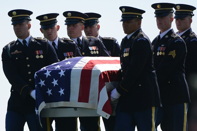 Soldiers, with the 3d U.S. Infantry Regiment (The Old Guard), carry the casket of Army Master Sgt. James W. Holt, who went missing and was presumed killed in action during the Vietnam War. Holt was buried with full military honors at Arlington National Cemetery, Va., May 14, 2015.