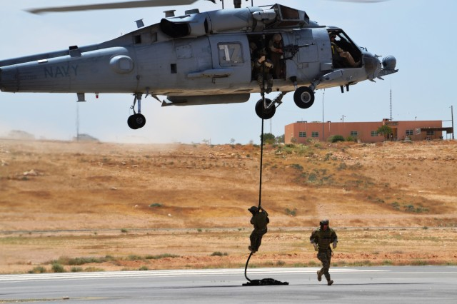 U.S. Special Operators conduct fast rope training as part of Exercise Eager Lion at the Prince Hashim Royal Air Base, May 9. Exercise Eager Lion 2015 is an annual, multinational exercise designed to strengthen military-to-military relationships, promote regional security and improve interoperability with partner nations.