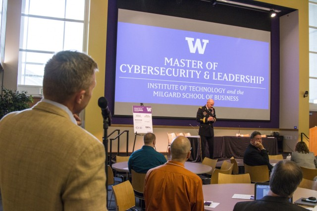 A member in attendance at the Northwest Cybersecurity Symposium asks a question to Lt. Gen. Edward C. Cardon at the University of Washington-Tacoma, Wash., on May 5, 2015. Cardon was one of the keynote speakers for the event, which was coordinated to bring various sectors of businesses and government together to discuss the safeguarding of the nation's infrastructure and network systems. (U.S. Army photo by Staff Sgt. Micah VanDyke, 19th Public Affairs Detachment)