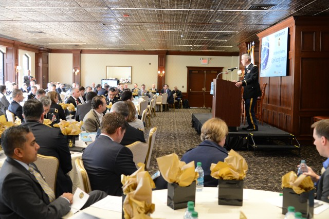 Col. Gregory Conti, director of the Army Cyber Institute, welcomes participants of the Joint Service Academy Cyber Security Summit held at West Point, N.Y., May 13-14. The overall goal of the summit is to strengthen the tie between industry and government organizations, to better secure the Internet, share best practices and foster stakeholder partnerships to defend and defeat threats facing the nation. (U.S. Army photo by Mr. Anthony F. Battista, West Point DPTMS Visual Information Department)