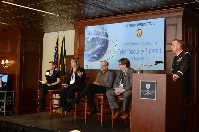 """Lt. Col. David Raymond, Army Cyber Institute director of Education and Research, moderates a panel discussion titled, """"Crypto Wars 2015: Competing Visions of Security"""", during the innagural Joint Service Academy Cyber Security Summit at West Point, N.Y., May 14, 2015. The overall goal of the summit is to strengthen the tie between industry and government organizations, to better secure the Internet, share best practices and foster stakeholder partnerships to defend and defeat threats facing the nation. (U.S. Army photo by Mr. Anthony F. Battista, West Point DPTMS Visual Information Department)"""