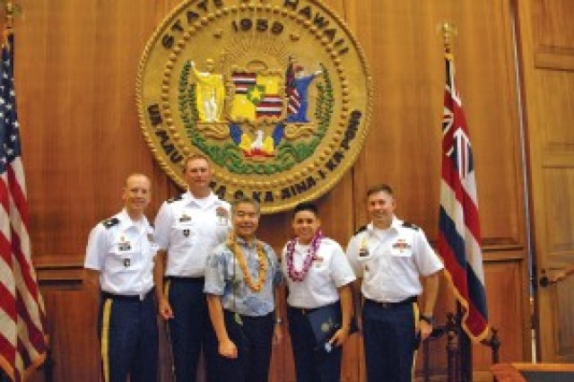 Spc. Alina Zamora, 307th Expeditionary Bn. (2nd from right in purple lei), was recognized during an HMAM ceremony, May 8, at the state capitol in Honolulu. To her left is Hawaii Gov. David Ige. Also photographed are Zamora's chain of command: from left, Lt. Col. Mark Miles, 1st Sgt. Brian Johnson and Capt. Lee Weyrick.