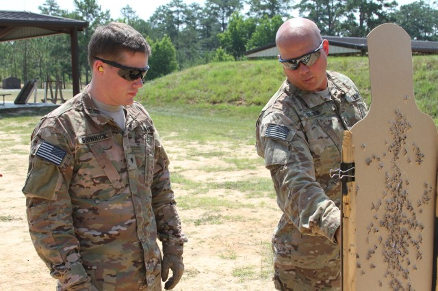 Spc. Kevin Shinnick, the 75th Ranger Regiment Best Warrior of the Year, receives a markmanship class from Sgt. 1st Class Jason St. John, the 75th Ranger Regiment Markmanship Program noncommissioned officer.