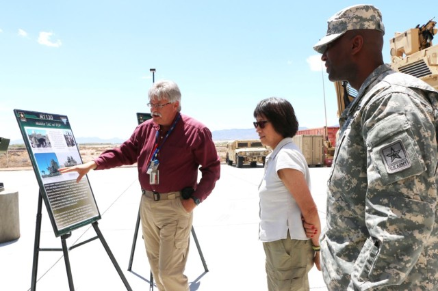 Jason Miller, engineer, Capability Package Directorate, briefs Assistant Secretary of the Army for Acquisition Logistics and Technology, Hon. Heidi Shyu and Col. Terrece Harris, director, Capability Package on a future Mobile TAC at the Command Post Integration Facility during NIE 15.2.