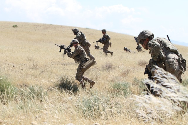 Soldiers from 1st Battalion, 187th Infantry Regiment, 3rd Brigade Combat Team, 101st Airborne Division (Air Assault) rush up a training range hill in Laghman Province, Afghanistan, during a combined arms live fire exercise May 13, 2015.  The exercise was conducted as a demonstration for an audience of senior leaders from the Train, Advise, Assist, Command-East and the 201st Afghan National Army Corps.
