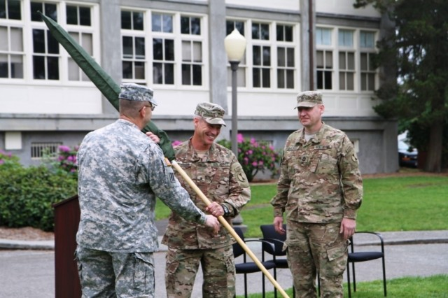 The 7th Inf. Div. Commander, Maj. Gen. Terry Ferrell (left), presented a set of cased colors to Task Force Bayonet Commander TAAC-S, Brig. Gen. Paul Bontrager and Sgt. Maj. Karl Zaglauer.