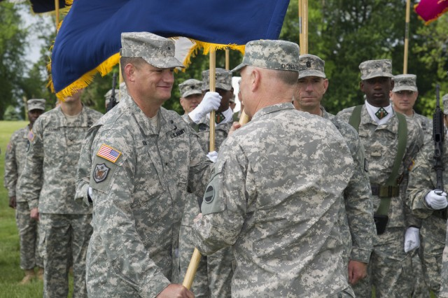 Brig. Gen. William E. King IV receives the 20th CBRNE Command colors from U.S. Army Forces Command Deputy Commanding General Lt. Gen. Patrick J. Donahue II during the change of command ceremony on Aberdeen Proving Ground, Md., May 20.