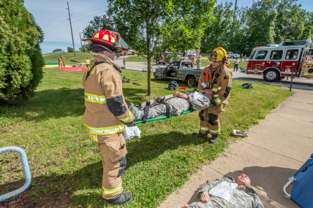 Members of the Fort Leonard Wood Fire Department evacuate a simulated victim injured from a tornado that was part of an exercise that tested the post's response actions and crisis management during a disaster.