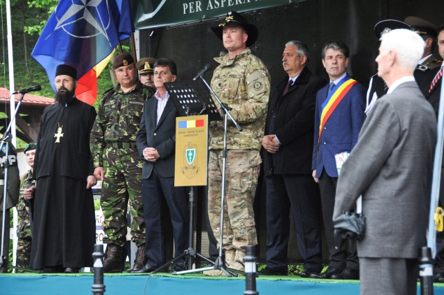 Lt. Col. Theodore A. Johnson (center,) squadron commander assigned to 2nd Squadron, 2nd Cavalry Regiment stands with The Honorable Mircea Dusa (right middle,) along with other Romanian leadership while giving a speech during a welcome ceremony held for 2nd Squadron in the city of Brasov, Romania while participating in the unit's Cavalry March from Mihail Kogalniceanu Air Base to the Cincu Training Center, Romania, May 14, 2015.