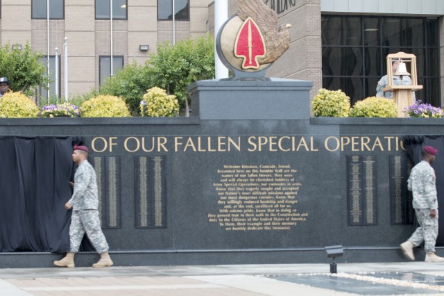 U.S. Army Soldiers unveil the Fallen Special Operations Soldiers Memorial Wall; U.S. Army Special Operation Command (USASOC) Headquaters; Ft. Bragg; N.C.; May 21; 2015.; USASOC has a memorial service every year in honor of special operations soldiers who have died in support of Operation Enduring Freedom or In Service to the Nation. (U.S. Army photo by Spc. David M. Shefchuk)