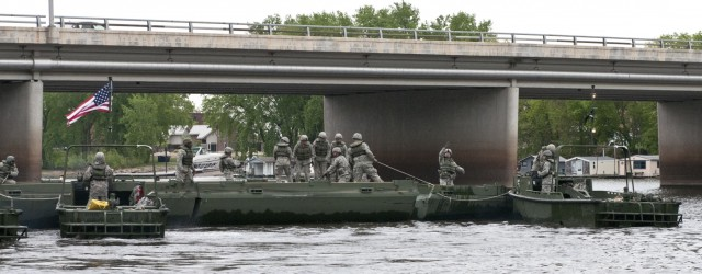 Bridging the Mississippi: Army Reserve bridge companies raft Mississippi during WAREX