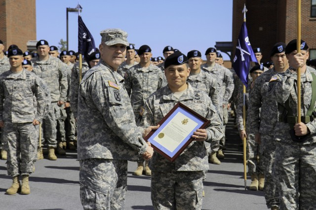 Major General Jeffrey L. Bannister (L), commander, U.S. Army Fort Drum & 10th Mountain Division, poses for a photograph with Lt. Col. Jonathan Chung, commander, 2nd Battalion 87th Infantry Regiment, who receiving the Meritorious Unit Commendation certificate and citation on behalf of Headquarters and Headquarters Company May 21 on Fort Drum.