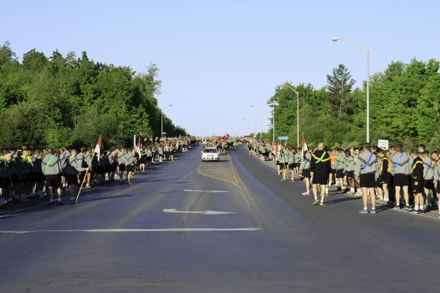 Soldiers assigned to the 10th Mountian Division (LI), Fort Drum, N.Y., line the streets wait to start a division wide safty stand down run May 22 on Fort Drum.