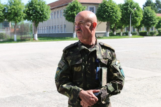 Brig. Gen. Tudorica Petrache, commander of 2nd Mountain Brigade, Romanian army, and a native of Tangoviste, Romania, attends the ROC drill in preparation for the upcoming Sarmis Training Exercise at Brasov Garrison, Romania, May 21, 2015.