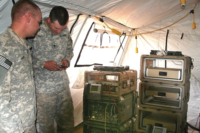 Soldiers from the 86th Expeditionary Signal Battalion evaluate the new CP 4G LTE/Wi-Fi system in May 2014 at NIE 14.2 on Fort Bliss, Texas. 4G LTE/Wi-Fi will obviate the need for myriad cables inside the CP and yield a system with a smaller footprint, reduced strategic lift requirements and reduced time for setup and teardown. (U.S. Army photo by Amy Walker, PEO C3T)