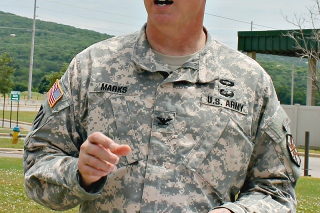 Garrison commander Col. Bill Marks holds a mock press conference at the Gate 9 Visitor Center as part of the disaster drill.