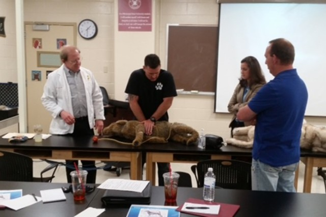K9 Officer Aaron Hanson practices CPR on a canine model