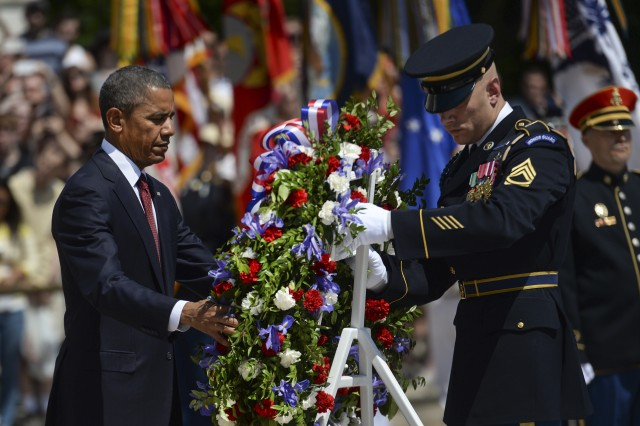 President Barack Obama lays a wreath at the Tomb of the Unknown Soldier to observe Memorial Day at Arlington National Cemetery in Arlington, Va., May 25, 2015.