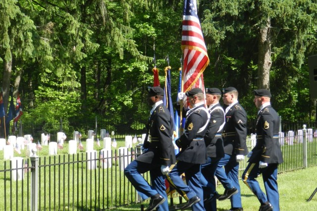The 20th CBRNE Command Color Guard posts the colors during the Memorial Day Ceremony May 25 at the Edgewood Area Cemetery on Aberdeen Proving Ground, Maryland.