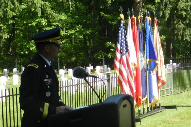 Brig. Gen. William E. King IV, the commanding general of 20th CBRNE Command, speaks during the Memorial Day Ceremony May 25 at the Edgewood Area Cemetery on Aberdeen Proving Ground, Maryland.