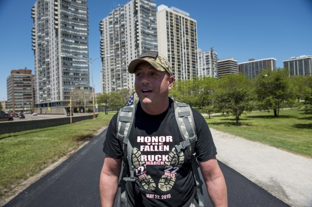 Sgt. 1st Class Joshua Hays, Army Reserve Soldier with the 317th Engineer Company, out of Kankakee, Illinois, marches along Kathy Osterman Beach roughly 12 miles into the Chicago Honor the Fallen Ruck March. Approximately 450 military veterans, service members and supporters gathered for a 22-mile ruck march on May 22, just days before Memorial Day, to honor military men and women who suffer from Post-Traumatic Stress Disorder or have committed suicide. (U.S. Army photo by Sgt. 1st Class Michel Sauret)