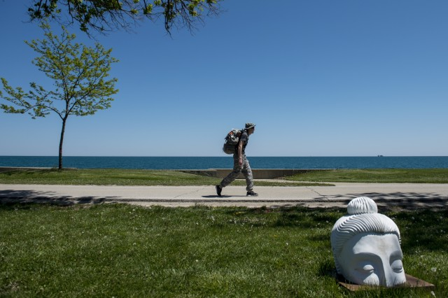... Sgt. Steve Doerener, an Army Reserve Soldier, marches along the Lakefront Trail 18