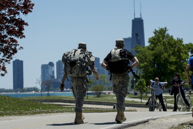 Two Soldiers march along the Lakefront Trail, roughly 18 miles into the Chicago Honor the Fallen Ruck March. Approximately 450 military veterans, service members and supporters gathered for a 22-mile ruck march on May 22, just days before Memorial Day, to honor military men and women who suffer from Post-Traumatic Stress Disorder or have committed suicide. (U.S. Army photo by Sgt. 1st Class Michel Sauret)