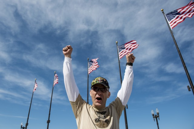 Lt. Col. Charles Lewis, Army Reserve operations officer for the 416th Theater Engineer Command, shouts with joy at Navy Pier after finishing the Chicago Honor the Fallen Ruck March. Approximately 450 military veterans, service members and supporters gathered for a 22-mile ruck march on May 22, just days before Memorial Day, to honor military men and women who suffer from Post-Traumatic Stress Disorder or have committed suicide. (U.S. Army photo by Sgt. 1st Class Michel Sauret)