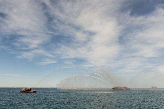 Two Chicago Fire Department boats spray arches of water at Navy Pier as a salute to approximately 450 military veterans, service members and supporters who marched a 22-mile ruck march on May 22, just days before Memorial Day, to honor military men and women who suffer from Post-Traumatic Stress Disorder or have committed suicide. (U.S. Army photo by Sgt. 1st Class Michel Sauret)