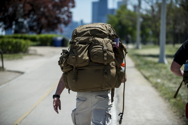 A Marine Corps veteran marches along the Lakefront Trail 18 miles into the Chicago Honor the Fallen Ruck March. Approximately 450 military veterans, service members and supporters gathered for a 22-mile ruck march on May 22, just days before Memorial Day, to honor military men and women who suffer from Post-Traumatic Stress Disorder or have committed suicide. (U.S. Army photo by Sgt. 1st Class Michel Sauret)