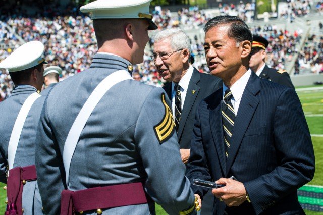 Former U.S. Army Chief of Staff Gen. (ret.) Eric K. Shinseki hands out 2nd lieutenant bars to United States Military Academy's class of 2015 graduating Cadets during a graduation and commissioning ceremony at West Point, NY, May 23, 2015.  (U.S. Army photo by Staff Sgt. Steve Cortez/ Released)