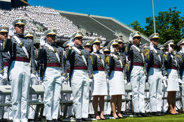 United States Military Academy Cadets of graduating class of 2015 raise their right hand as Commandant of Cadets Brig. Gen. John C. Thomsom III  commissions them into the U.S. Army at West Point, NY, May 23, 2015.  (U.S. Army photo by Staff Sgt. Steve Cortez/ Released)